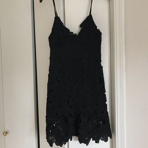 Black mini dress with floral details, size 4